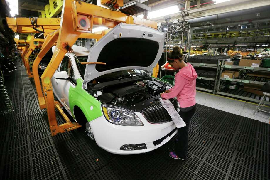 Final trim is installed on a Buick Verano at a GM plant in Orion Township, Mich. Photo: Carlos Osorio, STF / Copyright 2016 The Associated Press. All rights reserved. This material may not be published, broadcast, rewritten or redistribu