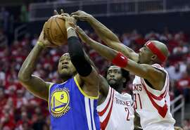 Golden State Warriors center Marreese Speights, left, shoots under pressure by Houston Rockets guard Jason Terry, right, and guard Patrick Beverley during the first half in Game 3 of a first-round NBA basketball playoff series, Thursday, April 21, 2016, in Houston. (AP Photo/David J. Phillip)