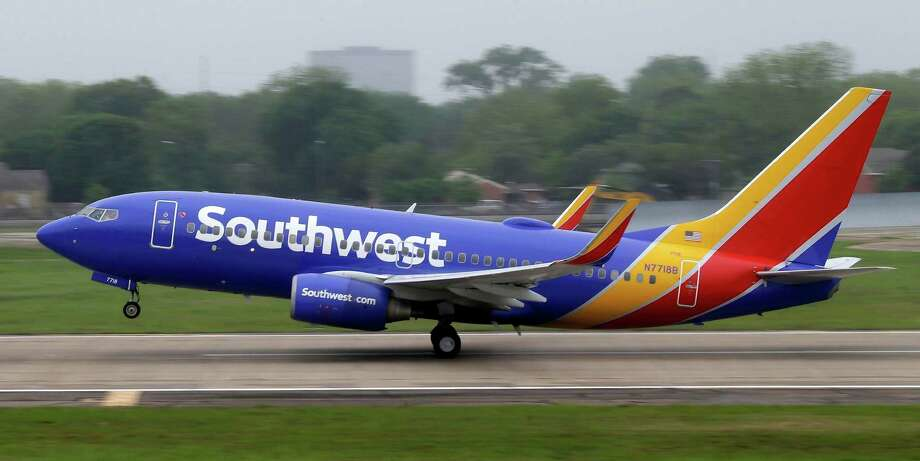 A Southwest Airlines jet takes off from a runway at Love Field in Dallas. Southwest reported a record first-quarter profit.  Photo: LM Otero, STF / AP