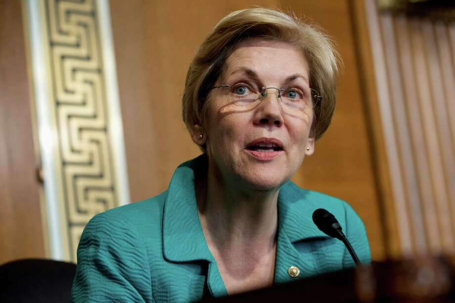 Sen. Elizabeth Warren wonders why Steven Cohen, who was prohibited from managing other people's money until 2018, helped start a new hedge fund.   Photo: Jacquelyn Martin, STF / AP