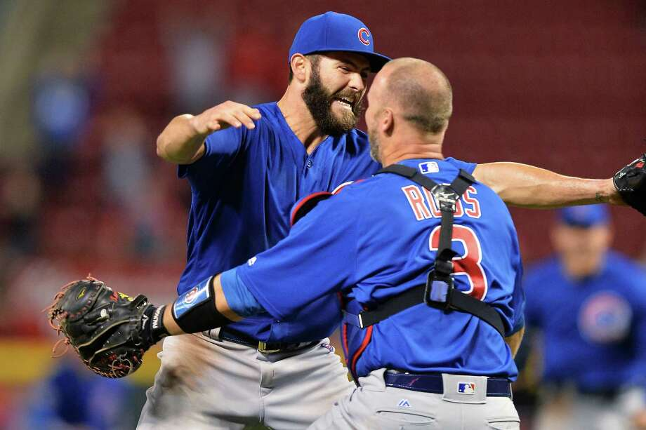 CINCINNATI, OH - APRIL 21:  Jake Arrieta #49 of the Chicago Cubs celebrates with catcher David Ross #3 of the Chicago Cubs after throwing a no-hitter against the Cincinnati Reds at Great American Ball Park on April 21, 2016 in Cincinnati, Ohio. Chicago defeated Cincinnati 16-0.  (Photo by Jamie Sabau/Getty Images) ORG XMIT: 607676157 Photo: Jamie Sabau / 2016 Getty Images
