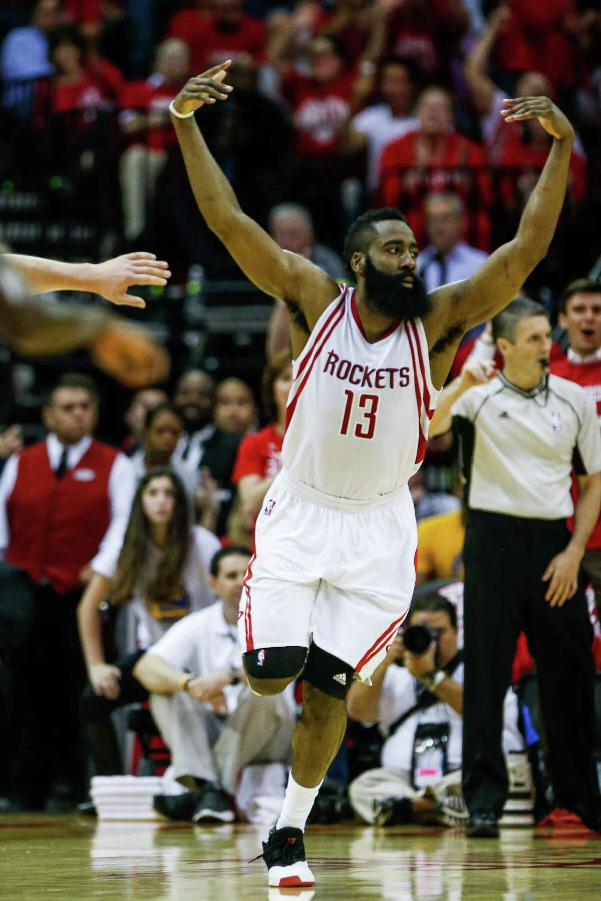 Houston Rockets guard James Harden (13) celebrates after a slam dunk against the Golden State Warriors during the second half in game three of a first-round NBA Playoffs series at Toyota Center Thursday, April 21, 2016 in Houston.