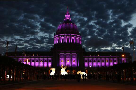 San Francisco pays tribute to the late musical artist Prince by lighting up city hall in purple lights on Thursday, April 21, 2016 in San Francisco, Calif.San Francisco pays tribute to the late musical artist Prince by lighting up city hall in purple lights on Thursday, April 21, 2016 in San Francisco, Calif.