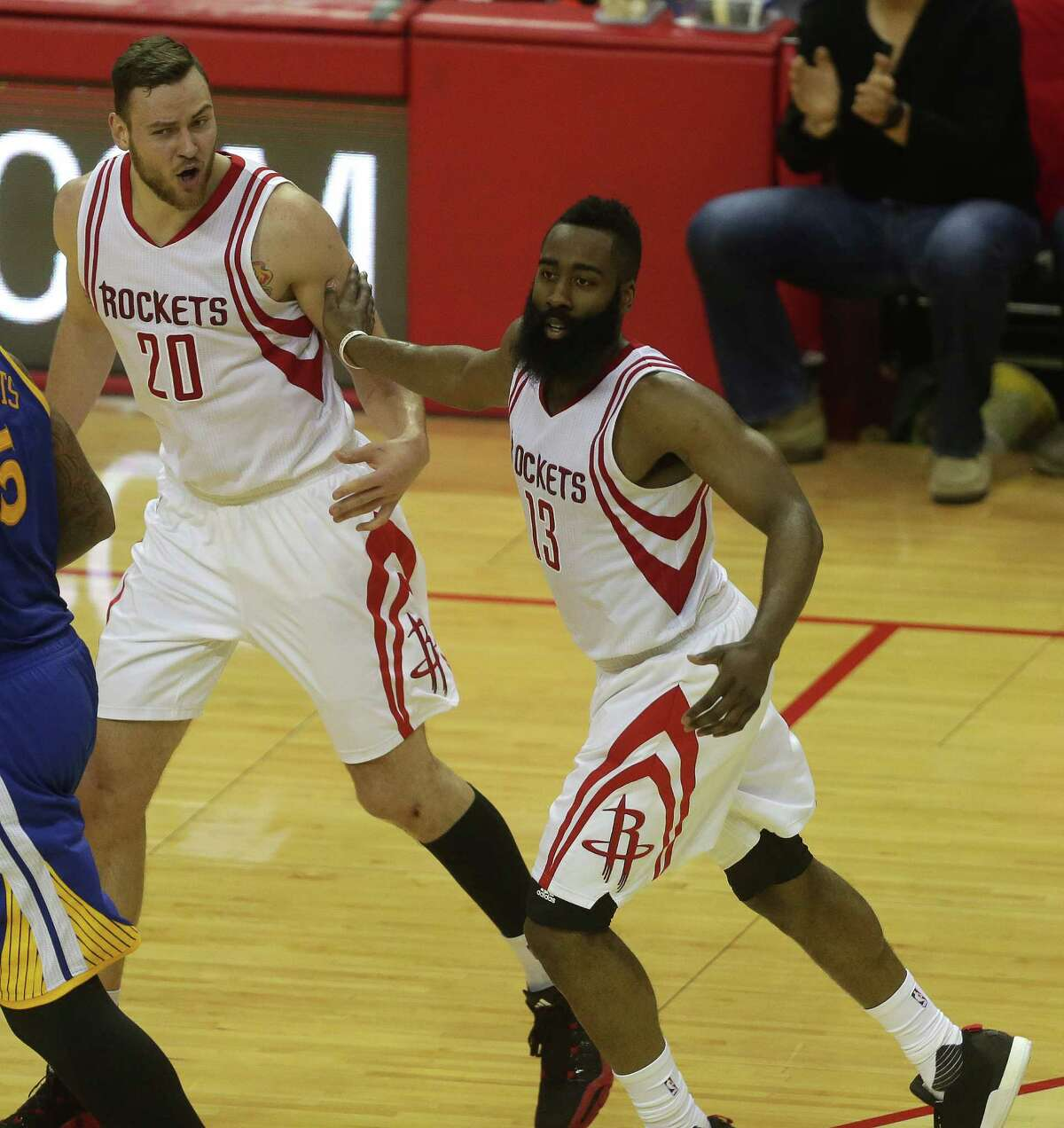 Houston Rockets guard James Harden (13) reacts after his basket with Donatas Motiejunas (20) during the second half in game three of a first-round NBA playoffs series at Toyota Center, Thursday, April 21, 2016, in Houston.