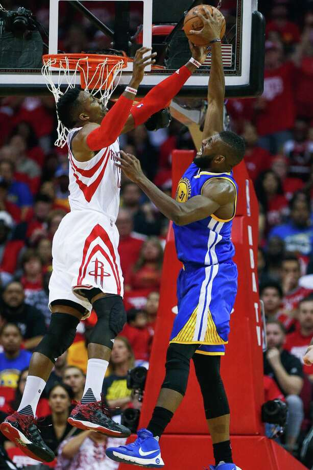 Houston Rockets center Dwight Howard (12) blocks a shot by Golden State Warriors center Festus Ezeli (31) during the first half in game three of a first-round NBA playoffs series at Toyota Center, Thursday, April 21, 2016, in Houston. ( Karen Warren / Houston Chronicle ) Photo: Karen Warren, Staff / © 2016 Houston Chronicle