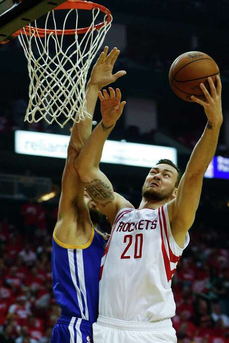 Houston Rockets forward Donatas Motiejunas (20) puts up a shot over Golden State Warriors center Andrew Bogut (12) during the first half in game three of a first-round NBA playoffs series at Toyota Center, Thursday, April 21, 2016, in Houston. ( Karen Warren / Houston Chronicle ) Photo: Karen Warren, Staff / © 2016 Houston Chronicle