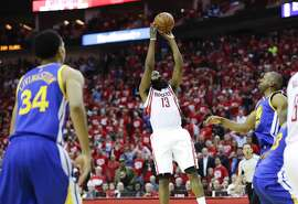 Houston Rockets guard James Harden scores the winning basket during the second half in Game 3 of a first-round NBA basketball playoff series against the Golden State Warriors, Thursday, April 21, 2016, in Houston. (AP Photo/David J. Phillip)