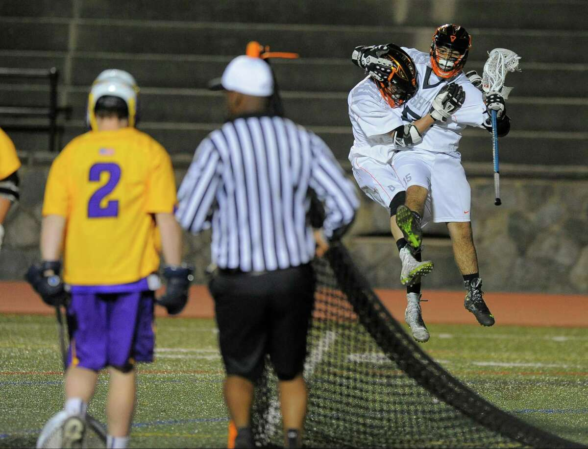 Stamford's Tony DePreta celebrates a first half goal with Jack O'Brien against as Westhill goalie Justin Wooley looks Wednesday night at Boyle Stadium. Stamford won the city championship.