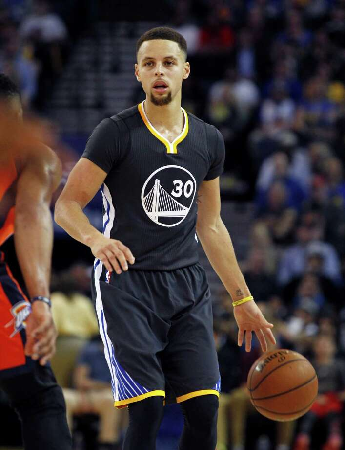 Golden State Warriors' Stephen Curry plays against the Oklahoma City Thunder during the second half of an NBA basketball game, Saturday, Feb. 6, 2016, in Oakland, Calif. (AP Photo/George Nikitin) Photo: George Nikitin, FRE / FR57659 AP