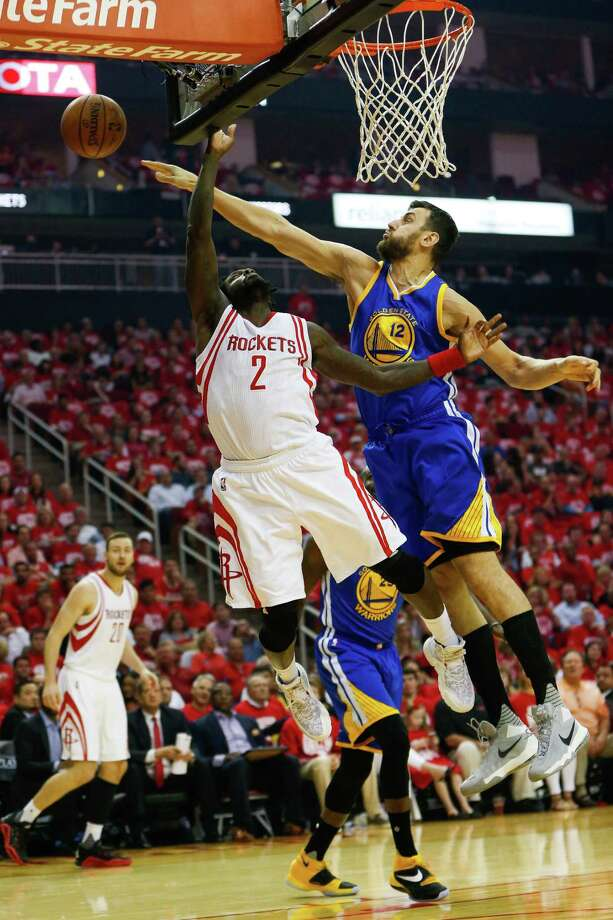 Golden State Warriors center Andrew Bogut (12) denies a shot by Houston Rockets guard Patrick Beverley (2) during the first half in game three of a first-round NBA playoffs series at Toyota Center, Thursday, April 21, 2016, in Houston. ( Karen Warren / Houston Chronicle ) Photo: Karen Warren, Staff / © 2016 Houston Chronicle