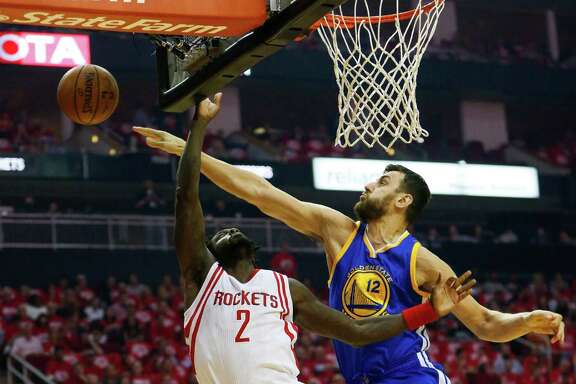 Golden State Warriors center Andrew Bogut (12) denies a shot by Houston Rockets guard Patrick Beverley (2) during the first half in game three of a first-round NBA playoffs series at Toyota Center, Thursday, April 21, 2016, in Houston. ( Karen Warren / Houston Chronicle )