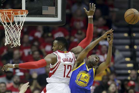 Houston Rockets center Dwight Howard, left, a Golden State Warriors guard Ian Clark battle for a loose ball during the first half in Game 3 of a first-round NBA basketball playoff series, Thursday, April 21, 2016, in Houston. (AP Photo/David J. Phillip)