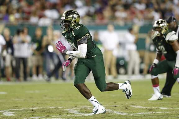 Eric Lee #91 of the South Florida Bulls in action against the East Carolina Pirates during the game at Raymond James Stadium on October 11, 2014 in Tampa, Florida. The Pirates defeated the Bulls 28-17. (Photo by Joe Robbins/Getty Images)