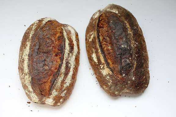 Tartine country bread (left) and Pain walnut bread (right) beside each other in San Francisco, California on tuesday, april 19, 2016.