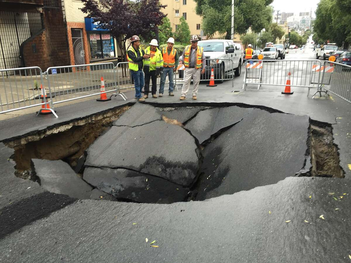 A large sinkhole formed on Sacramento Street between Lyon and Baker streets in San Francisco on April 21, 2016, after a sewer line broke.