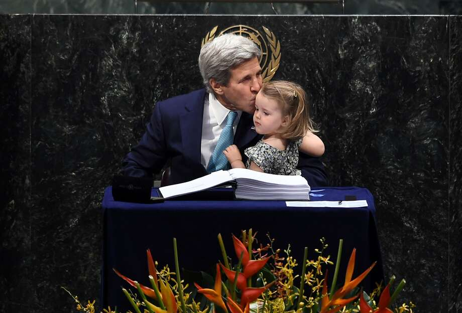 Secretary of State John Kerry kisses his granddaughter, Isabelle Dobbs-Higginson, after signing during the signature ceremony for the Paris Agreement at the U.N. General Assembly. Photo: JEWEL SAMAD, AFP/Getty Images