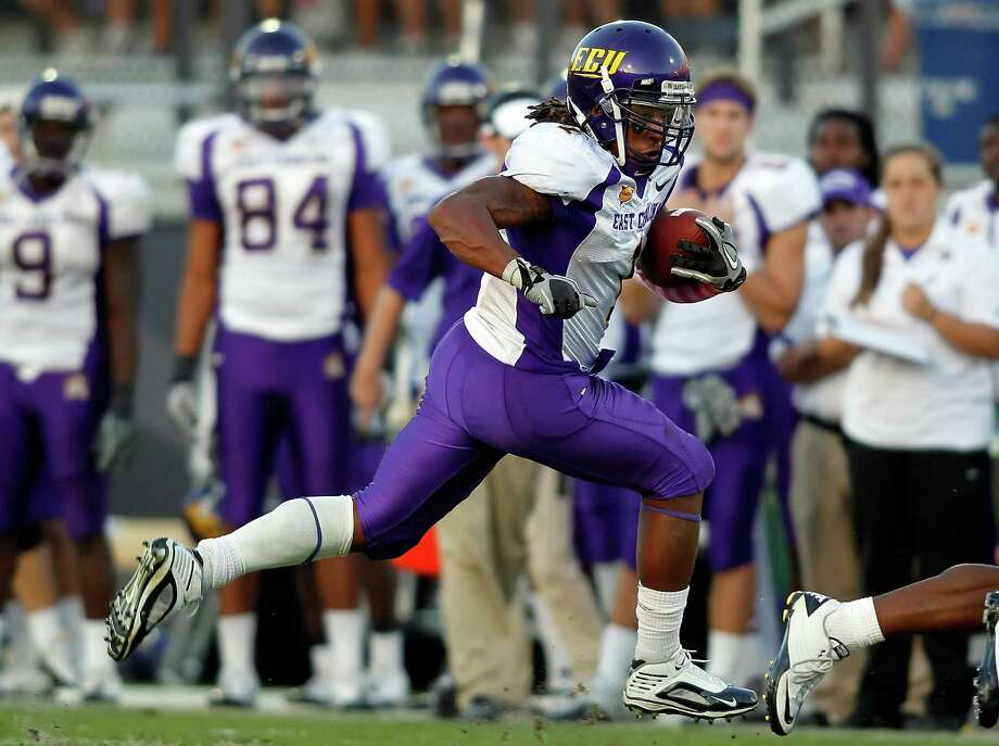 Running back Giavanni Ruffin of the East Carolina Pirates runs the ball against the Central Florida Knights during the game at Bright House Networks Stadium on October 30, 2010 in Orlando, Florida. Photo: J. Meric, Getty Images / 2010 J. Meric