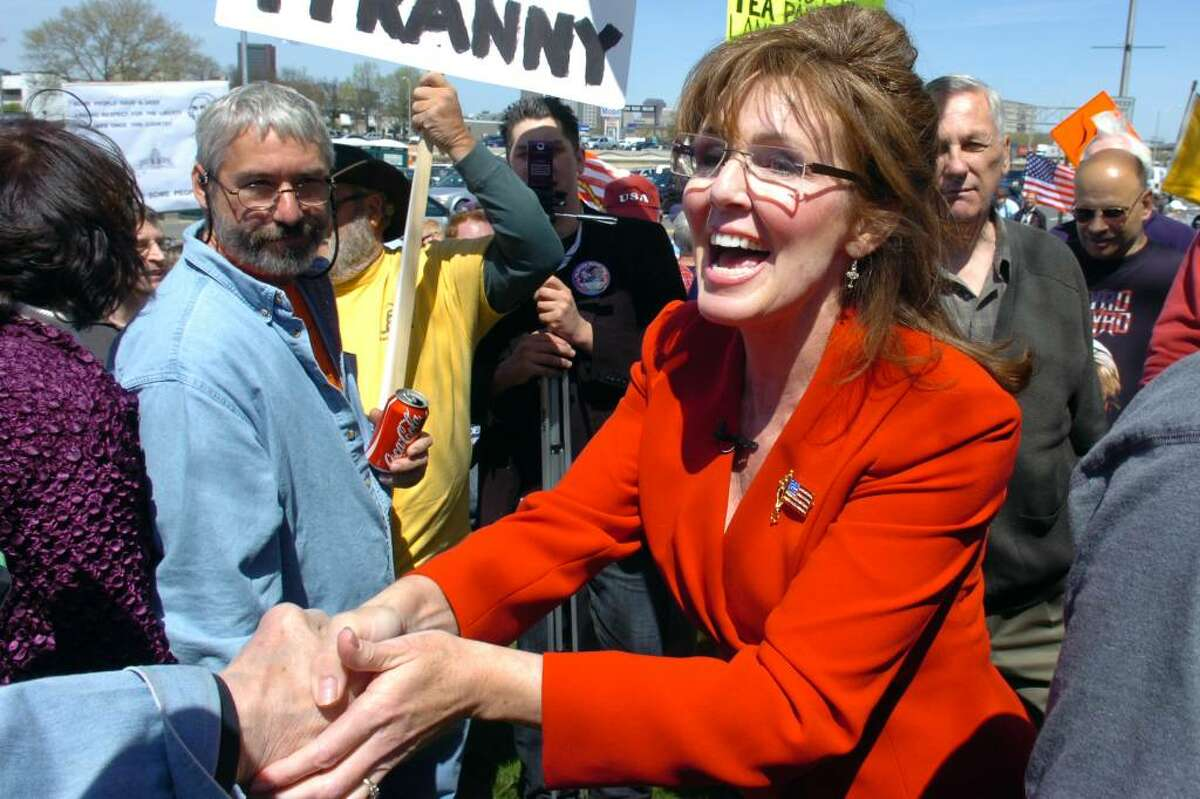 Patti Lyons, a Sarah Palin impersonator, greets the crowd during the Tax Day Tea Party in New Haven Thursday, April 15th, 2010.