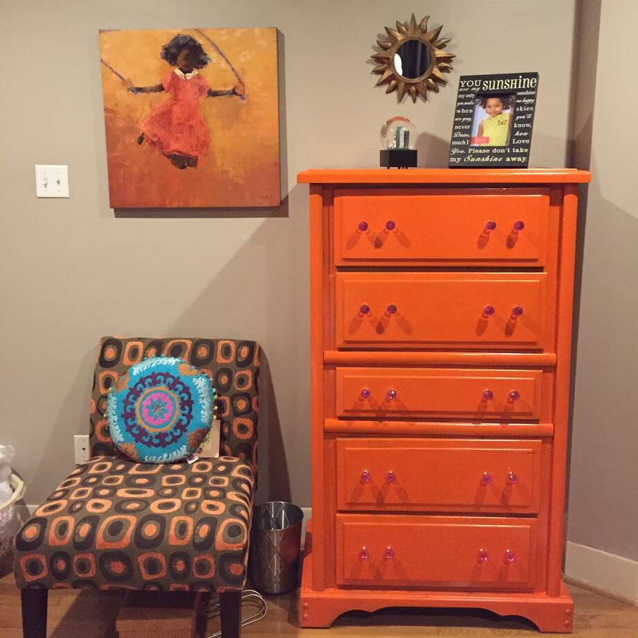 After: A plain chest of drawers is revitalized with orange spray paint. Photo: Joy Sewing