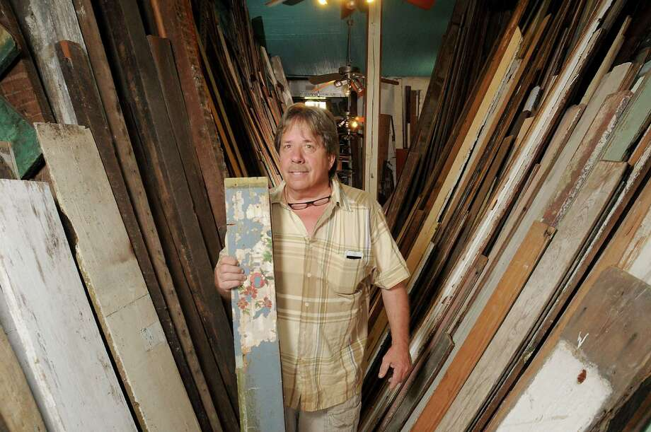Scotty Hanson with some of the old wood he has amassed at his workshop in Galveston Thursday April 14,2016.(Dave Rossman Photo) Photo: Dave Rossman, Freelance / Dave Rossman