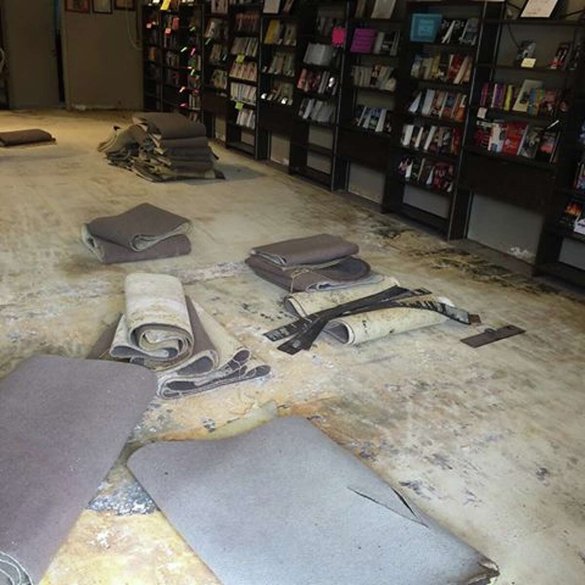 Drying out Water flowed into the store overnight Sunday, leaving the carpet wet and ruined. But Murder By The Book is still open and author events are still on the schedule.