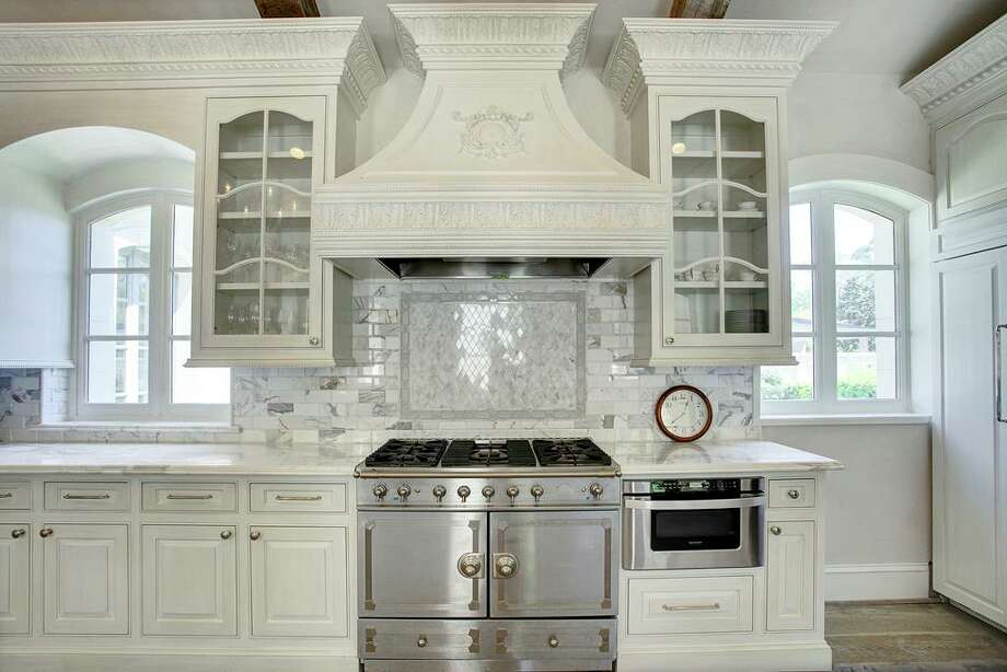 high end touches in this kitchen include a luxury french door style range - Houzz Photos Kitchen