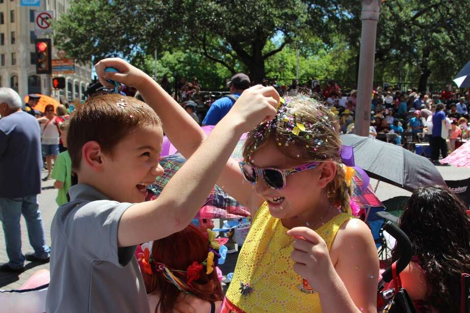 Two young parade enthusiasts get into the Fiesta spirit Friday, April 22, 2016. Photo: By Tyler White, San Antonio Express-News