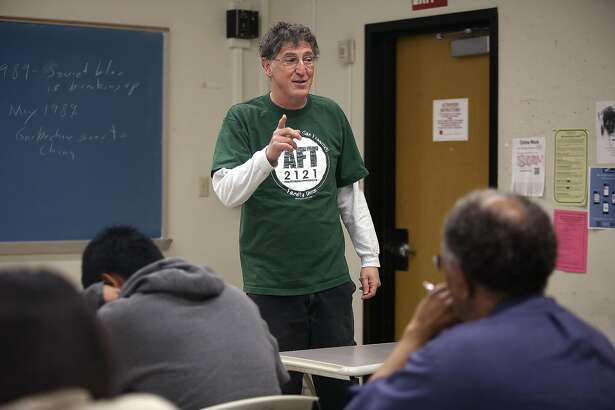 "City College of San Francisco instructor Tim Killikelly teaches ""The Politics of Globalization"" at CCSF in San Francisco, California on friday, april 22, 2016.  He is the union president of the American Federation of Teachers Local 2121."