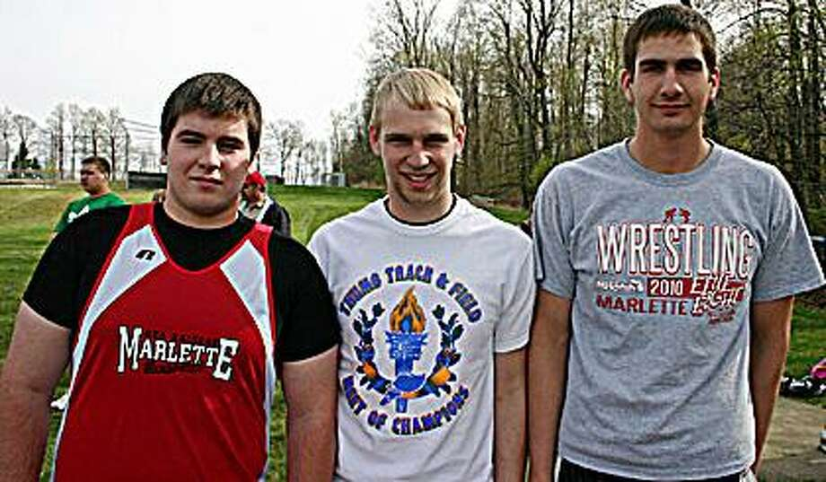 "The Marlette discus relay team placed first with a combined mark of 334'00.50"". Pictured are Anthony Hoisington, Brandon King and Patrick Dischinger. Photo by Marc Wilson."