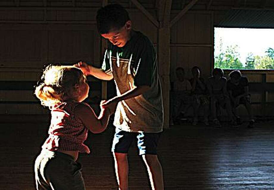 Madison Malmberg and Steven Edwards, 9, share a dance.