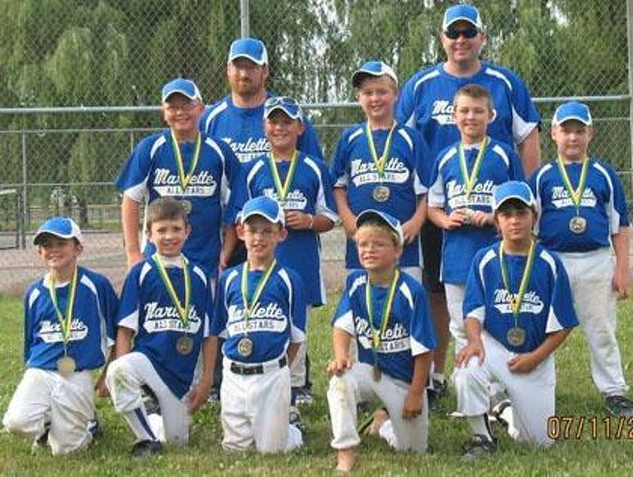 The Marlette Boys 10U All-Stars are shown with their 3rd place medals from the Brown City Tournament. Their record in this tournament was 3-2. Front row kneeling left to right are Andre' Korte, Sean Quade, Logan Marshall, Kolby Gyomory, Brett Havens. Middle row left to right Justin McClelland, Kyle Martinez, Marcus Armstrong, Alex Heussner, Chris Nickens. Back row left to right coach Nickens, Coach Quade Not pictured are James Hartwell and Kayden Maynard.