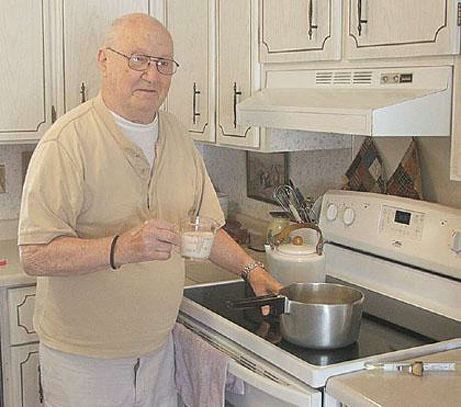 Marlette's Hugh Thompson starts his Tuesday morning ritual warming a pot of milk in preparation for making his homemade Peanut Butter Fudge. He has delivered the fudge to the residents at the Hospice House every Wednesday for the past seven and one-half years.