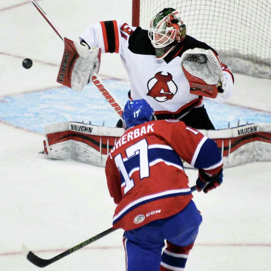 Albany Devils' goalie #31 Scott Wedgewood stops a shot on goal by St. John's IceCaps' #17 Nikita Scherbak during Saturday's game at the Times Union Center Jan. 23, 2016 in Albany, NY.  (John Carl D'Annibale / Times Union) Photo: John Carl D'Annibale / 10034967A