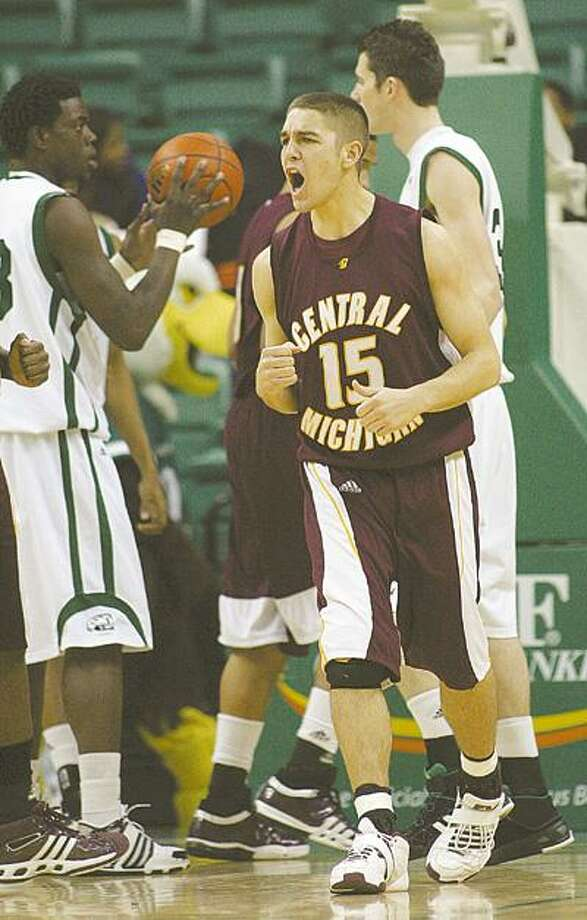 Central Michigan guard Jordan Bitzer (15) celebrates a basket in the first half of an NCAA college basketball game against Eastern Michigan, Tuesday, Jan. 13, 2009, in Ypsilanti, Mich. (AP Photo/Tony Ding) Photo: Tony Ding / FR143848 AP