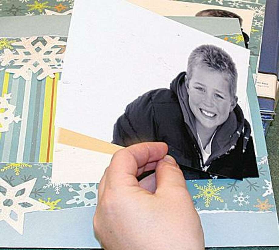 A scrapbook is created for Kegan Jackson's family.