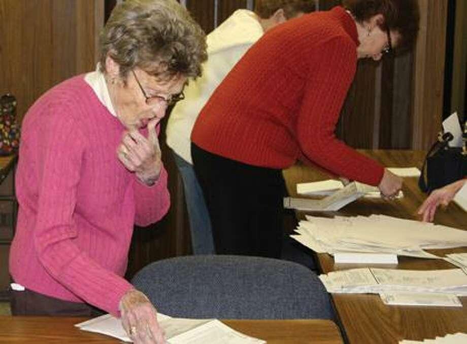 Roberta Stahl counts ballots.