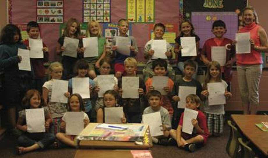 Caseville Elementary third graders write letters to pen pals.