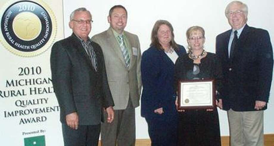 Marlette Regional Hospital was honored by The Michigan Center for Rural Health at an awards ceremony during the 11th Annual Michigan Critical Access Hospital Conference October 28, 2010 in Boyne Falls, Michigan. Pictured left to right is John Barnas, executive director, Michigan Center for Rural Health, Dan Babcock, MRH Interim CEO, Deb Sherman, MRH HIM Manger, Sherry Ely, MRH director of Quality and Risk Management, and Wm. J. (Bill Hart), Michigan Department of Community Health.