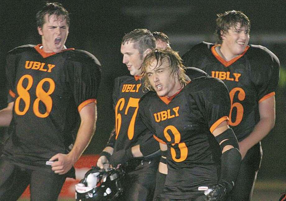 Ubly players Steven Weber (88), Steve Gilbert (67) and Bryan Nash (3) celebrate after the win.