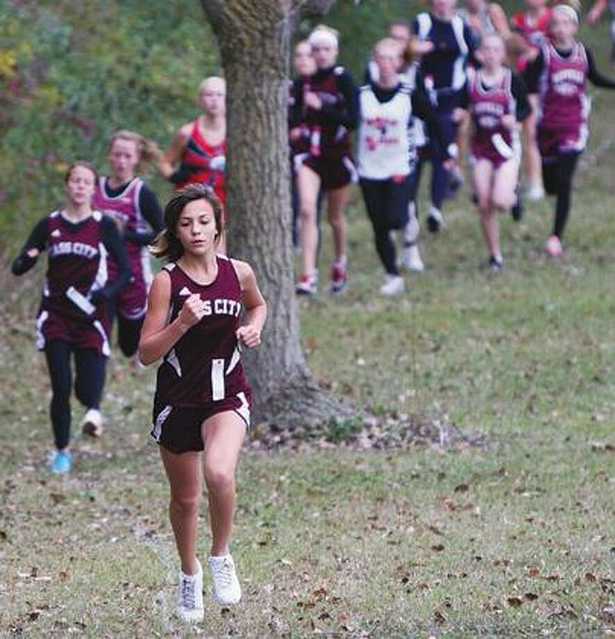 Cass City freshman Alyssa Bennett leads the pack on Saturday near the start of the Ubly Invite. Bennett led the Red Hawks to a sweep of the top three spots, along with teammates Ashley Potts and Jessa Prieskorn.