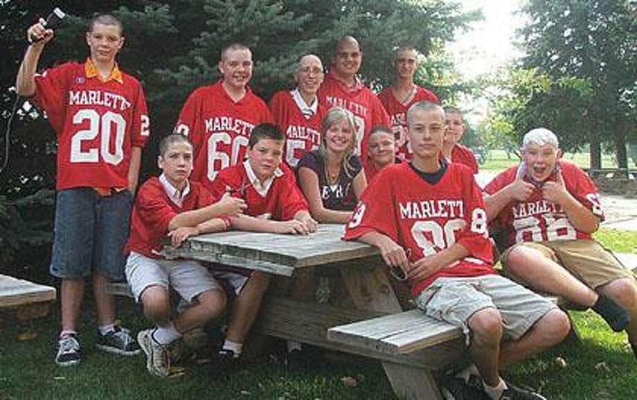 Members of the Marlette seventh and eighth grade junior high football team had their heads shaved on Tuesday, September 21st as a show of support for classmate Katie Shaver who is undergoing chemotherapy for cancer.