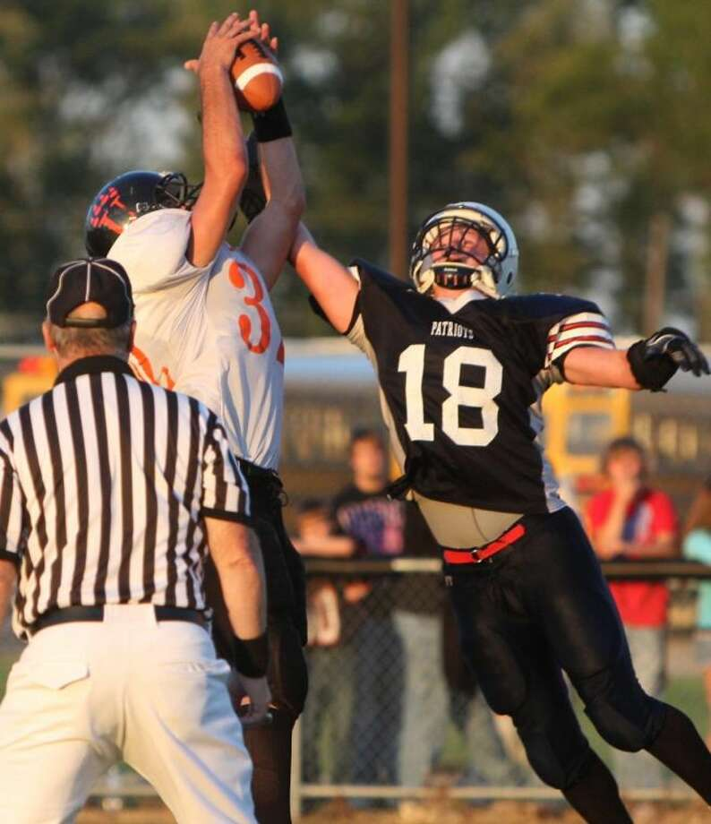 Ubly's Eric Booms hauls in a pass against Unionville-Sebewaing Area earlier this season.