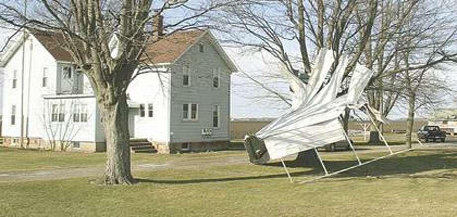 High winds that left thousands across the state without power also prompted some to call their insurance agent to report damage to roofs, trees and other structures. This picture was taken along Sebewaing Road near Sebewaing on Monday afternoon. Stacy Langley/ Huron Daily Tribune