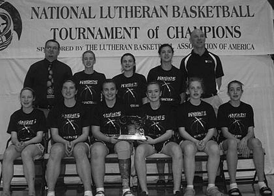 Christ the King Lutheran School of Sebewaing team members are (front row from left) Jennifer W., Stephanie N., Mackenzie E., Katie G., Haley E., Erika F, (back row) head coach David Kumm, Sarah R., Kaylie B., Gabrielle N. and assistant coach Jamie Ewald.