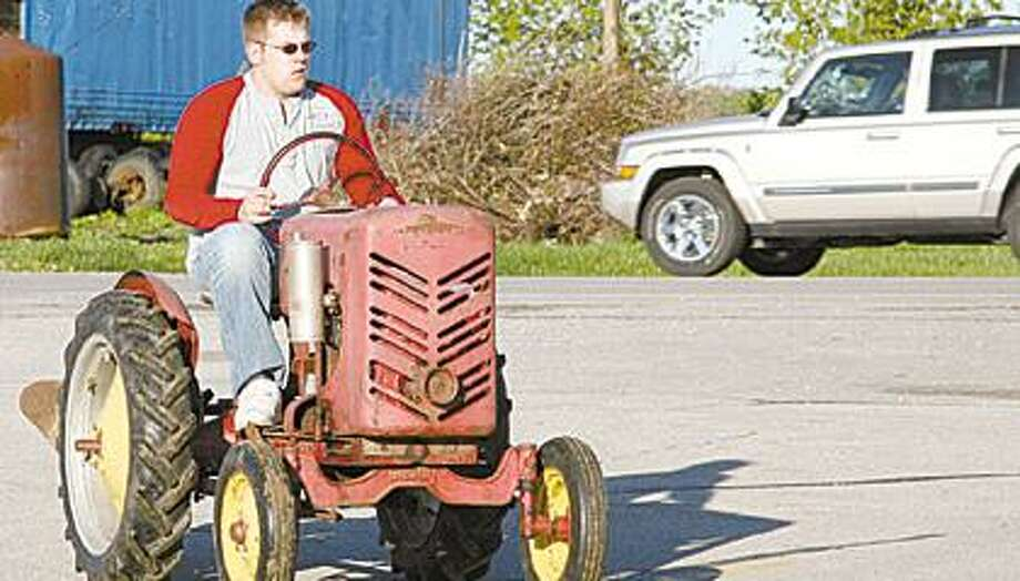 The first tractor to arrive at the school was driven by Ryan Smith.
