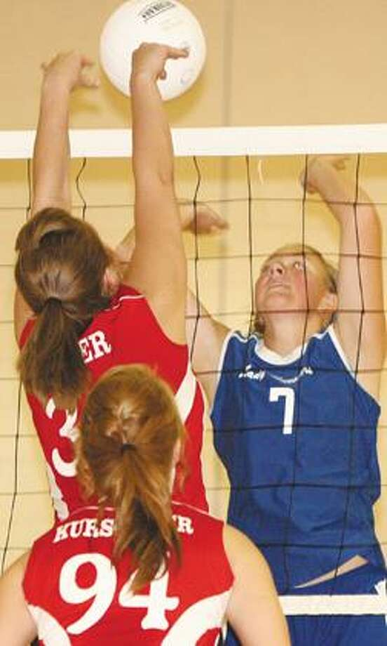 Caseville's Veronica Sauer (33) works the net against Port Hope's Kayla Gust during Game 1 on Tuesday.