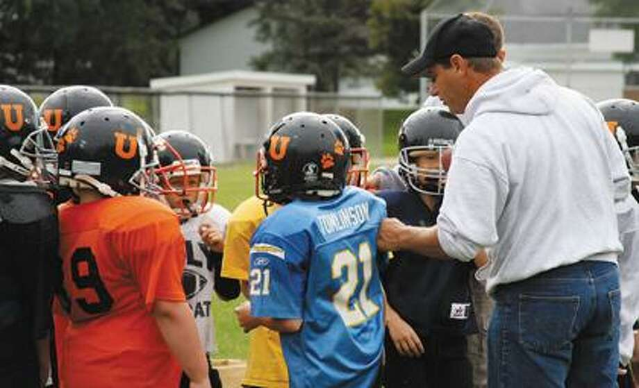 Scott Wright coaching third and fourth graders.
