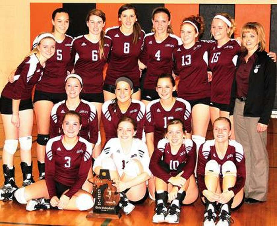 The Cass City volleyball team is all smiles after capturing the Class C district crown on Saturday night.