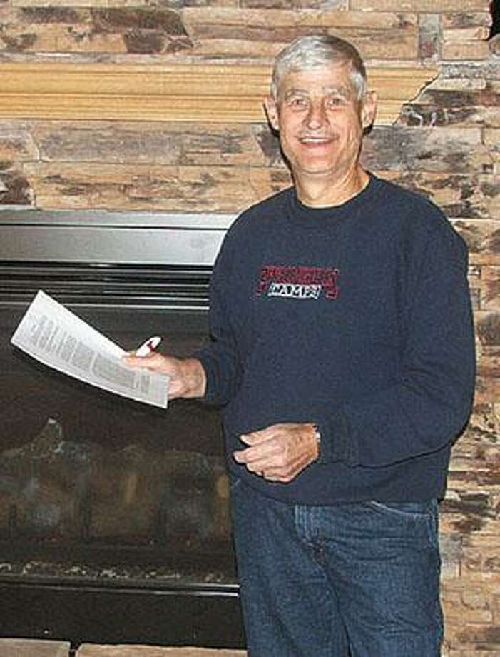 A proud Pastor Mike Hollenbeck holds the lease to the new Marlette Community Center which is slated to open to the public later this month.