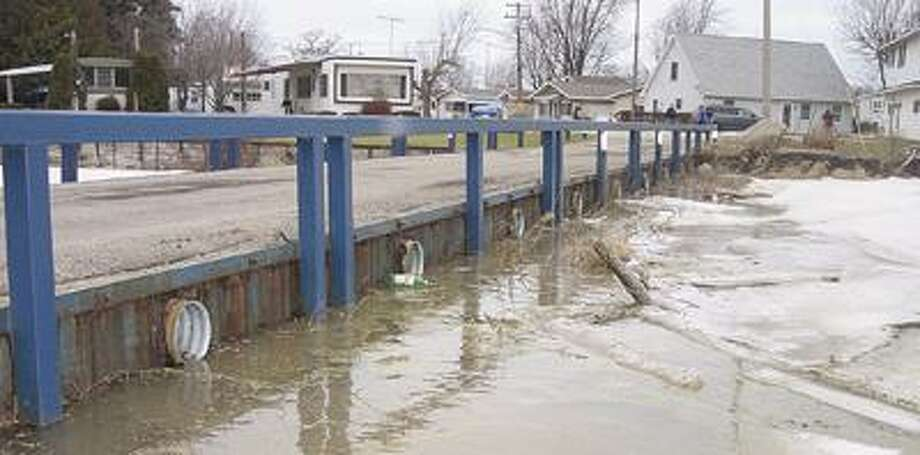Aaron Hessling/Huron Daily Tribune Ice jams, photographed Tuesday at the Beadle Island bridge off River Street, caused flooding in Caseville.